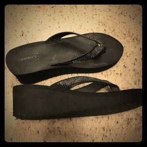 Black wedge flip flops